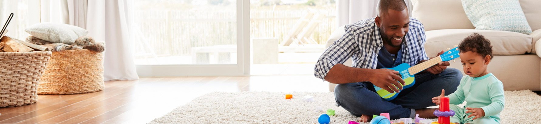 Man and child playing with toys in living room
